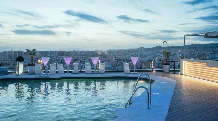 The AC Málaga Palacio rooftop terrace bar and pool