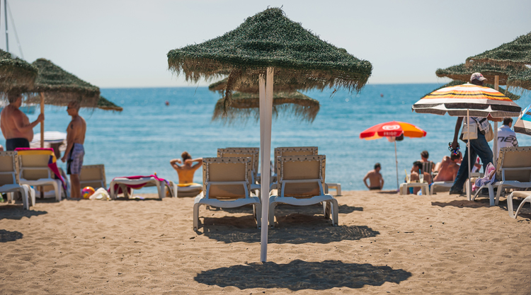Tourists pack the beaches of Torremolinos on the Costa del Sol